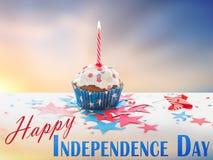 Queque com vela no Dia da Independência americano Imagens de Stock