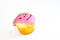 Queque cor-de-rosa de Biten isolado no branco Fotos de Stock Royalty Free