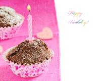 Queque do aniversário com uma vela Foto de Stock Royalty Free