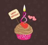 Queque do aniversário com vela iluminada na forma do número oito ilustração royalty free