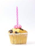 Queque e vela cor-de-rosa Imagens de Stock Royalty Free