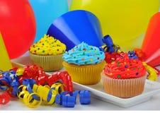 Queques coloridos Imagens de Stock