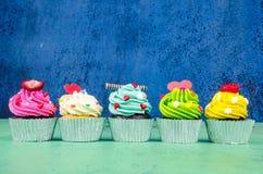 Queques coloridos Foto de Stock Royalty Free