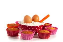 Queques com refeição e ovos Imagens de Stock Royalty Free