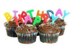 Queques do chocolate do feliz aniversario no branco Fotografia de Stock