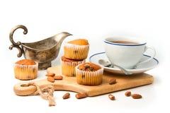 Queques e copo de café Foto de Stock