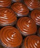 Queques geados do chocolate Imagem de Stock Royalty Free