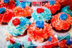 Queques vermelhos, brancos, e azuis Fotos de Stock