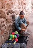 Mexican man selling handcrafts and other objects. QUERETARO, QUERETARO / MEXICO - 06 22 2017: Mexican man selling handcrafts and other objects stock photo