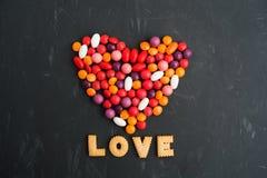 Querido colorido de muitos doces com AMOR Foto de Stock Royalty Free
