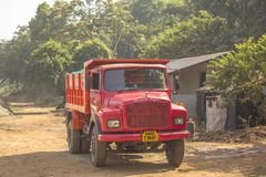 Red indian truck on the background of the hut and green forest royalty free stock image