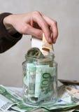 Querneigung mit Geld stockfotografie