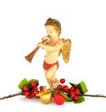 Querube de la Navidad - muñeca, manzanas y acebo antiguos Imágenes de archivo libres de regalías