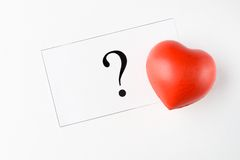 Query mark and heart Stock Image