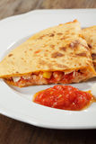 Quesadilla. With chicken meat, corn, and cheese served with salsa and sour cream stock photo