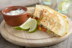 Quesadilla. On a round cutting board royalty free stock image