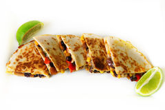 Quesadilla appetizer with lime Stock Photos