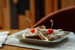 Quesadilla beef with cherry tomatoes on white rectangular plate stock photos