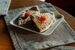 Quesadilla beef with cherry tomatoes on white rectangular plate stock photo