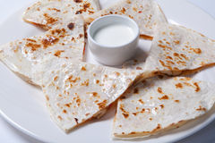 Quesadilla with beef and chicken on a white plate. quesadilla and sauce. Stock Images
