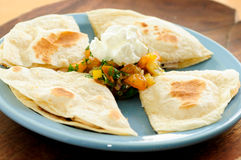 Quesadilla. Chicken quesadilla with salsa and sour cream stock images