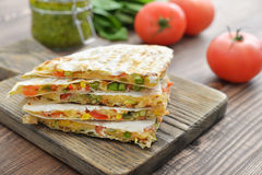 Quesadilla with chicken. Stack of mexican Quesadilla with chicken, corn, sweet pepper and tomato Royalty Free Stock Images