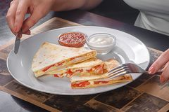Quesadilla with chicken and tomatoes, two sauce. S from tomatoes and sour cream. Low key. Side view Stock Image