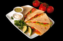 Quesadilla Mexican Food. A delicious quesadilla filled with cheese, tomatoes and lettuce stock photos