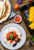Quesadilla, salad with cottage cheese and tomatoes, two corn on wood table. Top wiev. Fresh dinner Stock Photo