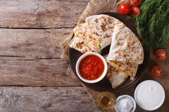 Quesadilla sliced and sauces on the table. horizonta top view Stock Image