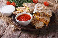Quesadilla slices on a plate and sauces closeup. horizontal Stock Photo