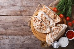 Quesadilla with sour cream and tomato sauce horizontal top view Royalty Free Stock Photography