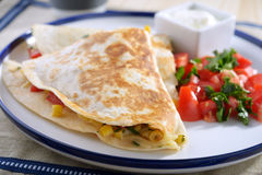 Quesadilla. With vegetables on a plate royalty free stock image