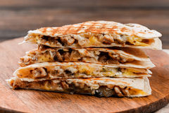 Quesadilla on a wooden table. Close-up shot stock images