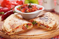 Quesadillas with chicken meat and vegetables. Mexican quesadillas with chicken meat, cheese and vegetables Stock Images