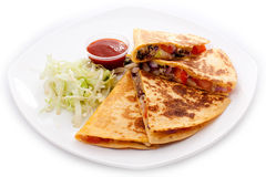 Quesadillas cut into four pieces with ketchup. And lettuce on a white plate, white background isolated stock photography