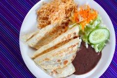 Quesadillas rice salad frijoles sauce Mexican food Royalty Free Stock Photos