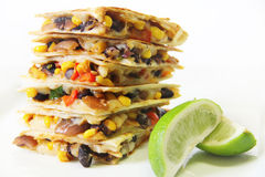 Quesadillas stacked with lime. Shot of quesadillas stacked with lime Royalty Free Stock Photo
