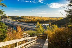 Quesnell Bridge - fall 2015, Edmonton, Alberta,Canada. View to Quesnell Bridge in Edmonton from wooden steps at north side of the North Saskatchewan river stock photos