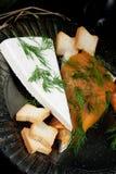 Queso de la especialidad con los salmones Fotos de archivo libres de regalías