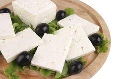 Queso de queso Feta en la placa de madera Imágenes de archivo libres de regalías