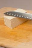 Queso de soja y cuchillo Fotos de archivo