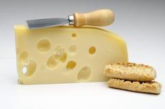 Queso del emmental con crostini Foto de archivo libre de regalías