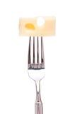 Queso del emmental en una fork Imágenes de archivo libres de regalías