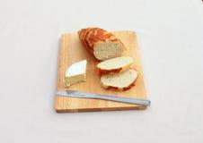 Queso en el pan Imagenes de archivo
