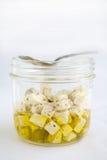 Queso Feta en aceite de oliva Fotografía de archivo