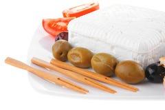 Queso Feta y aceitunas con la tostada Imagen de archivo libre de regalías