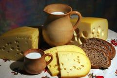 Queso, leche y pan Imágenes de archivo libres de regalías