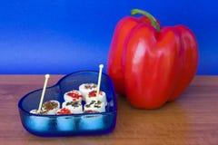 Queso sazonado y pimienta roja Foto de archivo