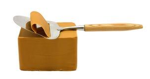 Queso y cortador de queso marrones noruegos Fotos de archivo
